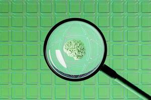 cubos vacíos con una lupa en el centro que muestra un cerebro foto