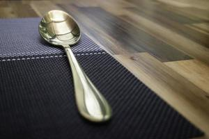 Gold spoon on table photo