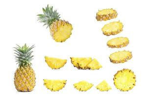Collection of sliced pineapples isolated on white background. photo