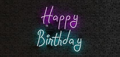 letrero de neón con la frase feliz cumpleaños sobre un fondo oscuro foto