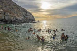 People enjoying vacation at Punta Lobos in Todos Santos Baja California Sur Mexico photo