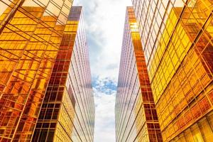 Golden tall buildings and glass reflections in Hong Kong Island, business concepts of buildings and architecture photo