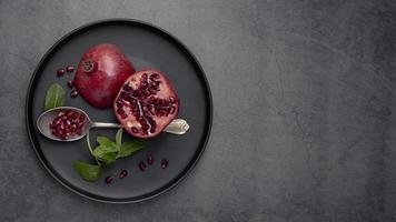 Top view plate with mint and pomegranate photo