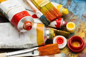 Various colours and sizes of paint photo