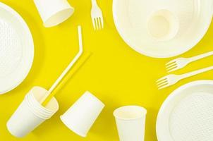 Various white plastic disposable tableware photo