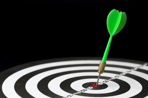 High angle dart stuck on target bullseye photo