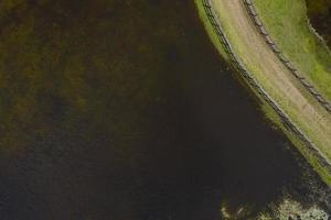 Aerial photograph of a horse trotting track near a fresh water lake in New South Wales in regional Australia photo