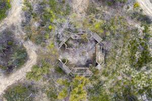 Aerial photograph of structural ruins and forest after bushfires in regional Australia photo