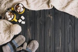Mugs with marshmallows near warm weather accessories photo