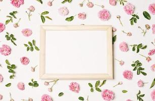 Photo frame collection of pink flowers with green leaves