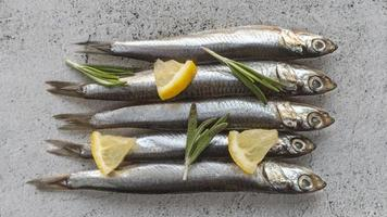 Raw fish with lemon photo