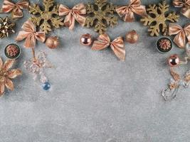 Snowflakes with bows on gray background photo