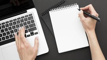 Top view desk concept with laptop photo