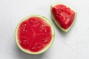 Top view of sliced watermelon on white background photo