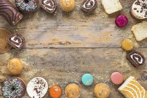 Pastries border a wooden background photo
