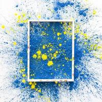 Photo frame with blue and yellow bright dry paint colors