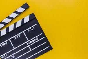 Popcorn box with cinema tickets on yellow background photo