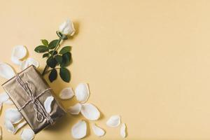 Present with rose petals and copy space photo