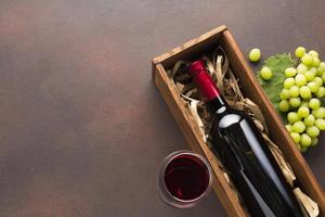 Red wine case with white grapes photo