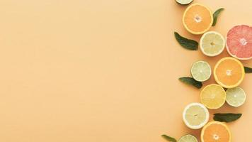 Sliced oranges and lemons with copy space photo