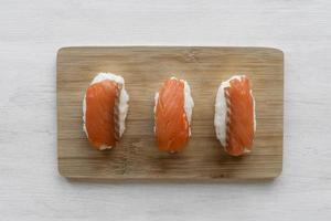 Salmon sashimi on cutting board photo
