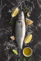 Whole fish on marble background photo