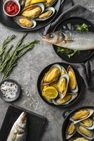 Raw seafood being prepared with lemon and herbs photo