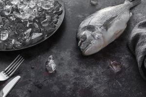 Whole fish on ice photo
