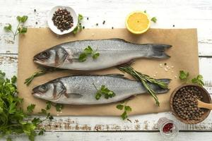Whole fish seasoned with lemon and herbvs photo