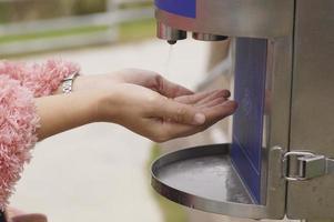 Women sanitizing hands photo