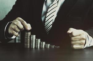 Businessman staking money photo