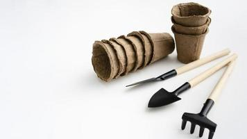 Top view gardening tools with peat pots photo