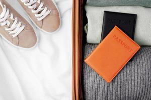 Passport and suitcase, preparing to travel photo