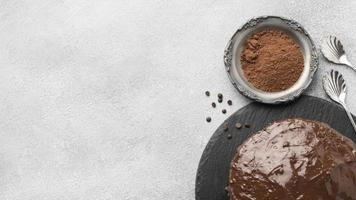 Top view chocolate cake with cocoa powder and copy space photo