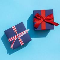 Top view cute gifts on blue background photo