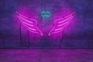 Lámpara rosa neón con alas de ángel en una habitación vacía foto