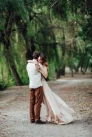 A guy and a girl are walking along the banks of a wild river overgrown photo