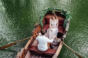 A boat trip for a guy and a girl along the canals and bays of the river photo