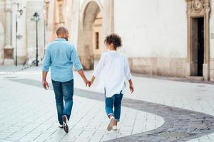 Guy and a girl happily walk in the morning on the empty streets photo