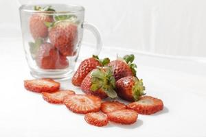 Sliced strawberries with white background photo