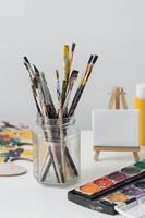 Paint brushes on artist background photo