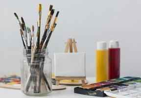 Paint brushes on white background photo