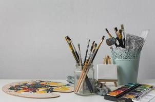 Paint brushes on artist desk photo
