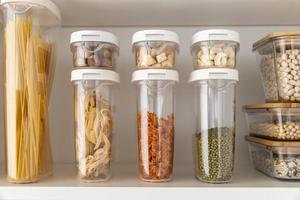 Food storage containers on shelves photo