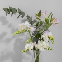 Blossom flower in vase on table photo