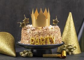Birthday cake with gold decorations photo