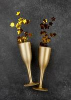 Gold champagne flutes on grey background photo