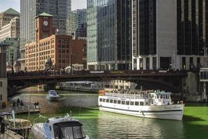 Chicago, Illinois, Mar 17, 2017 - Boats on the Chicago Riverwalk during St Patrick's Day photo