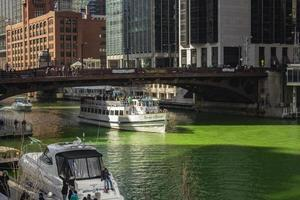 Chicago, Illinois, Mar 17, 2017 - People celebrating St Patrick's Day on the green river photo
