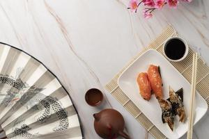 Sushi on bamboo placemat photo